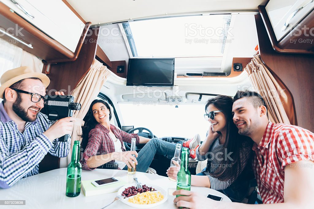 Group of young people having fun in a caravan stock photo