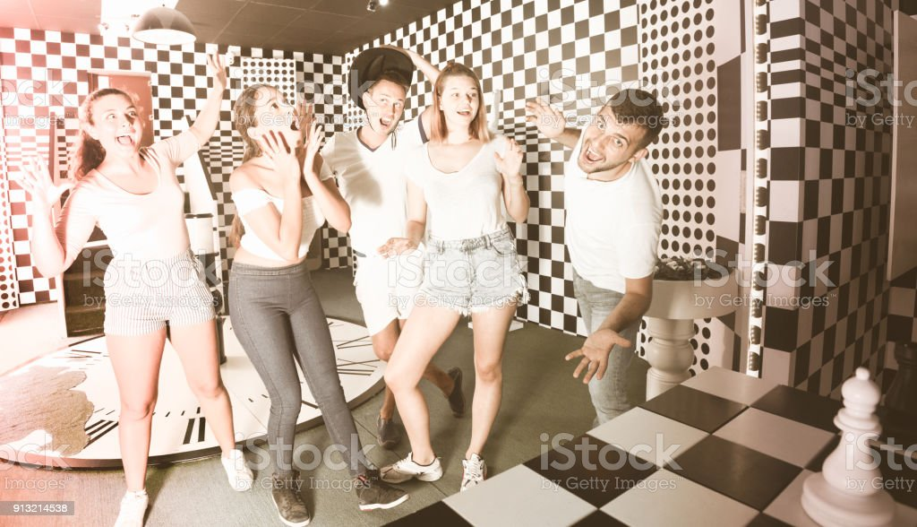 Group of young people having fun in escape room stock photo