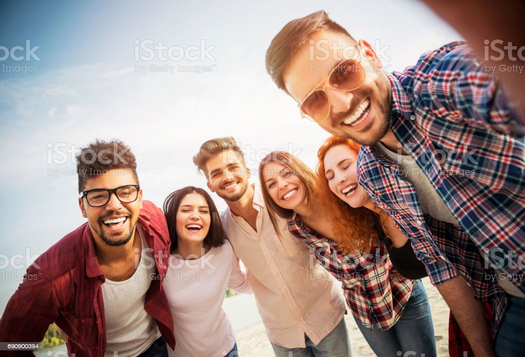 Group of young people having fun outdoors royalty-free stock photo