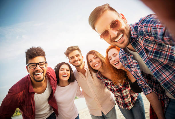 Group of young people having fun outdoors stock photo