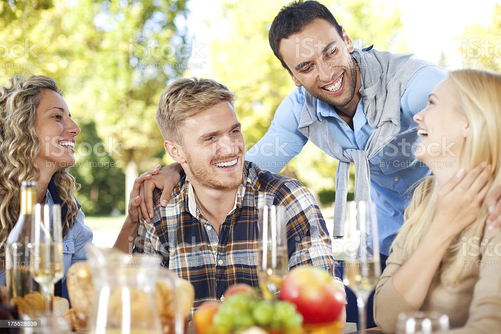 Group of young people having picnic in park royalty-free stock photo