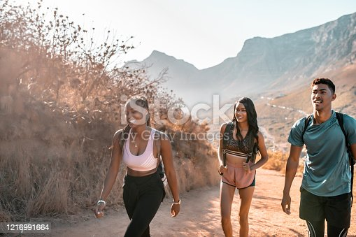 Three young people hiking Lions head, Cape Town