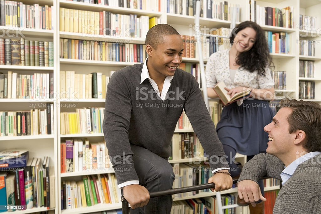 Group of young people in a library royalty-free stock photo