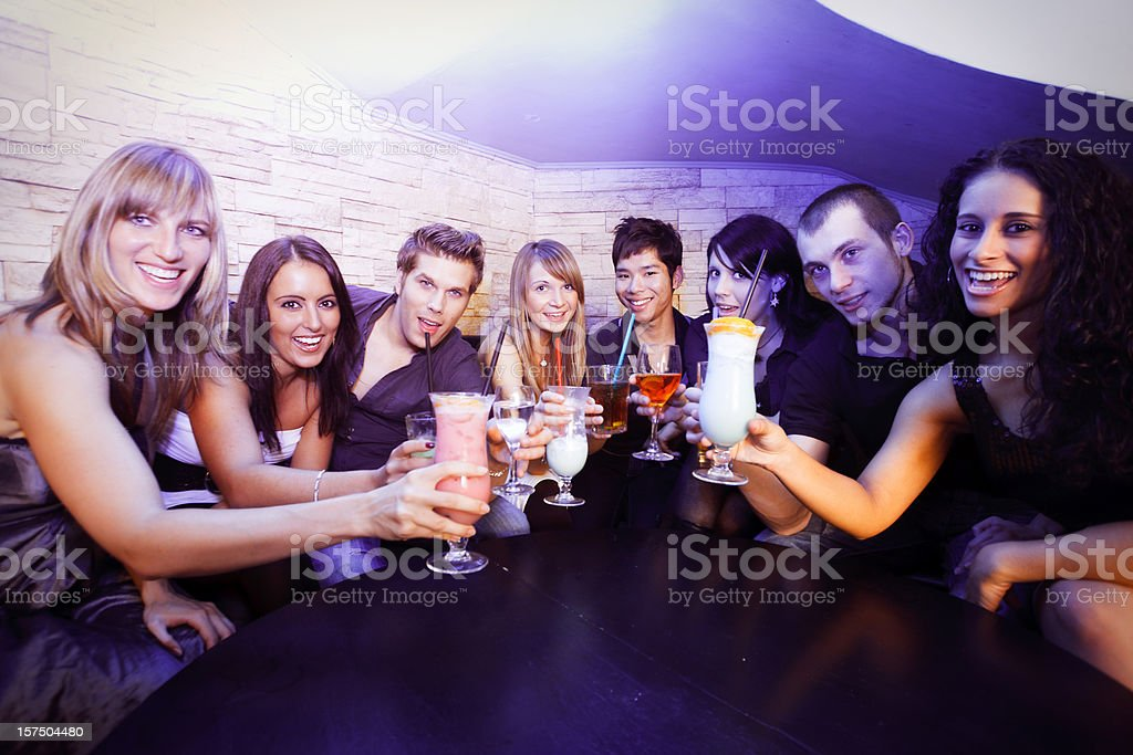 group of young people in a nightclub royalty-free stock photo
