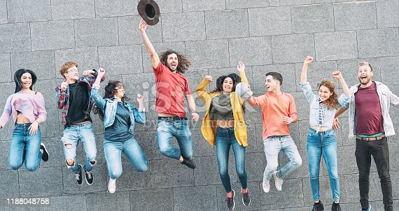 861023492 istock photo Group of young people jumping together outdoor - Happy millennial friends celebrating success in college - Youth culture lifestyle and friendship concept 1188048758