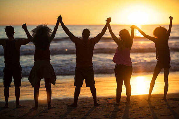 Group of young people looking at sunset stock photo