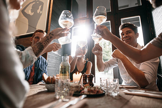 Group of young people making a toast stock photo