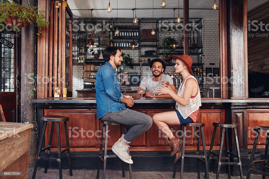Group of young people meeting in a coffee shop stock photo