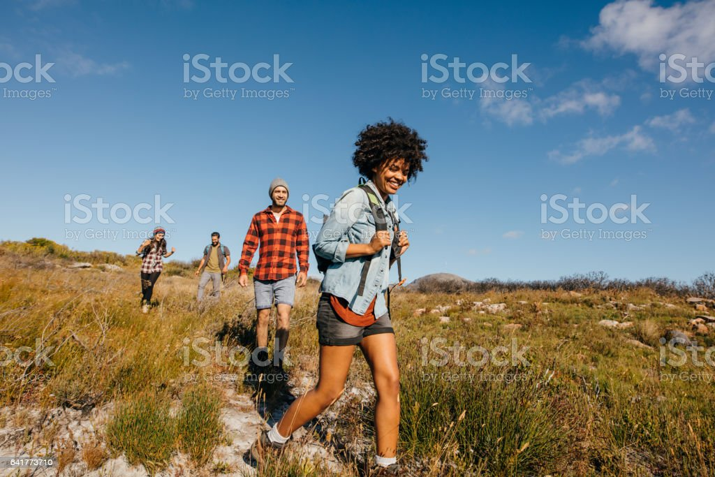 Group of young people on a hike stock photo