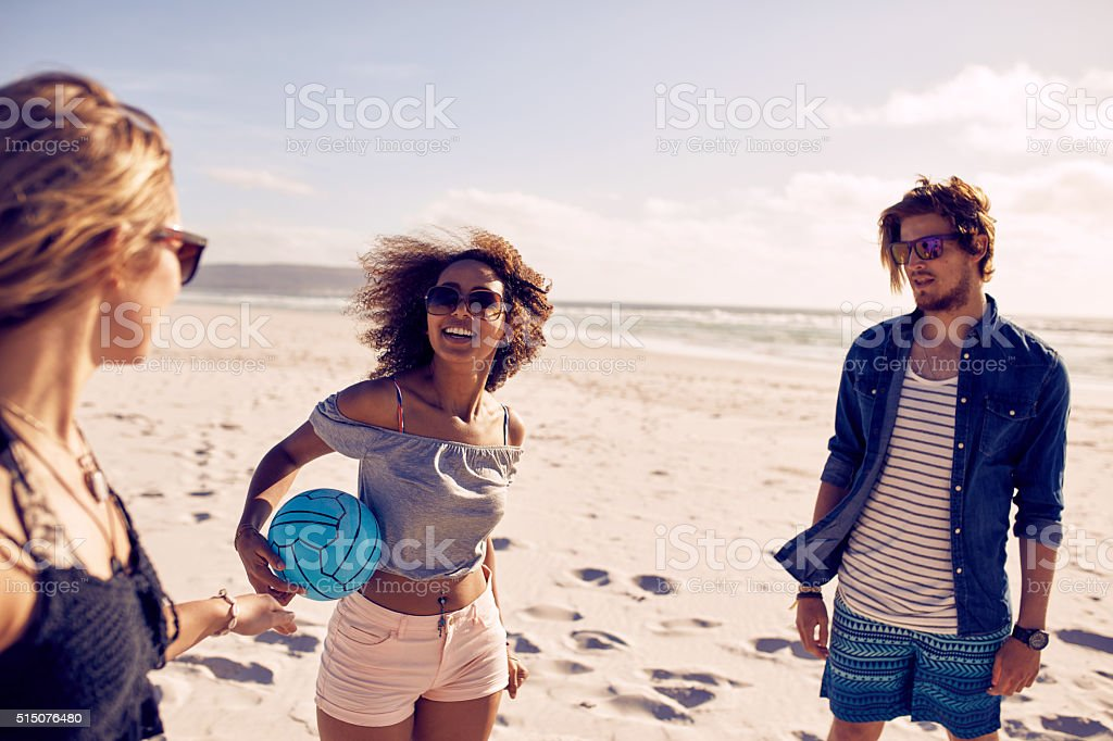 Group of young people on the beach stock photo