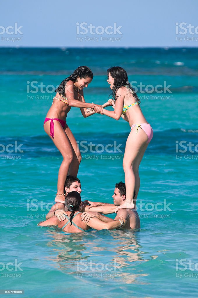 Group of Young People Playing in Ocean on Sunny Day royalty-free stock photo
