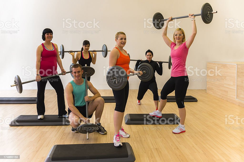 Group of young people posing in the gym royalty-free stock photo