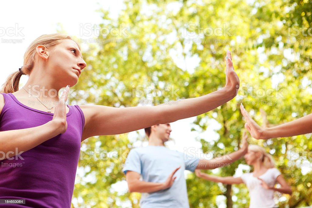 Group of Young People Practicing Tai Chi Outdoor stock photo