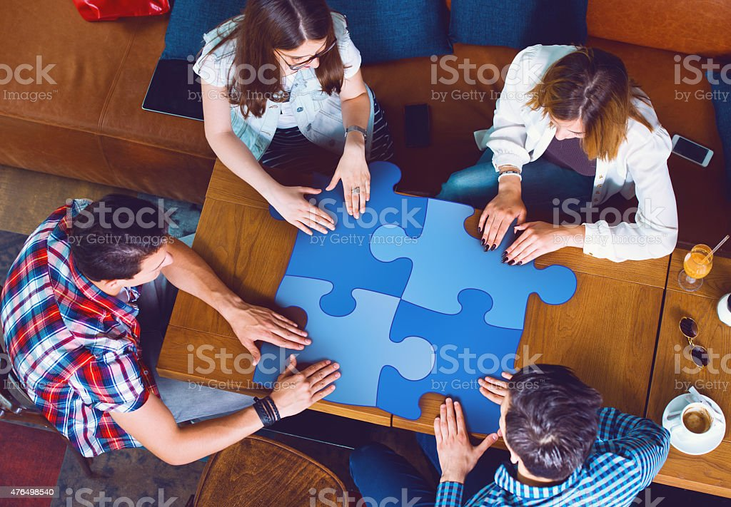 Group of young people sitting at a cafe stock photo