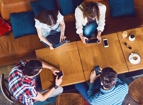 Group Of Young People Sitting At A Cafe Top View Stock Photo - Download Image Now