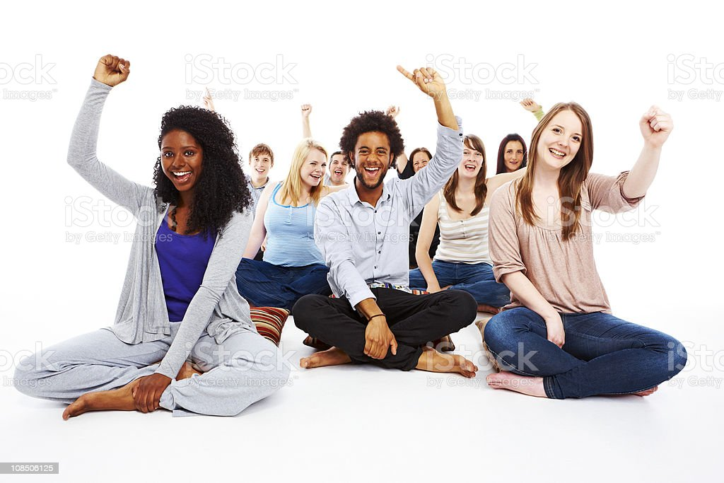 group of young people sitting cheering royalty-free stock photo