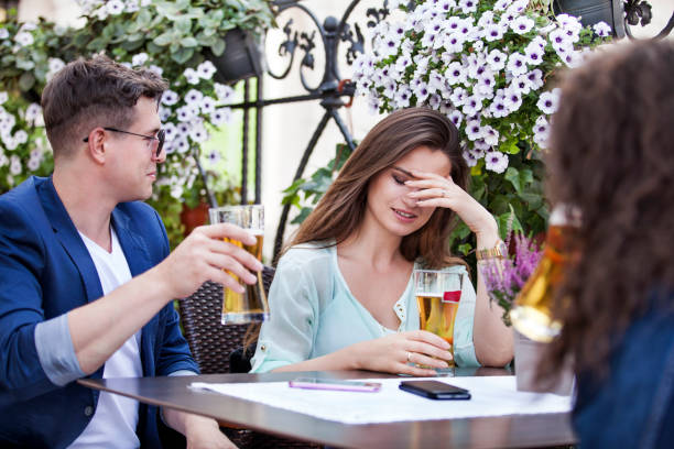 Group of young people sitting in a beer garden stock photo