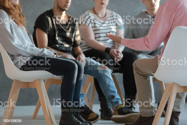 Group of young people sitting in a circle and talking to psychiatrist picture id1004109250?b=1&k=6&m=1004109250&s=612x612&h=1gf2ax  w w0so fo9vyoj1lg7xyshl3aycfykyiptk=