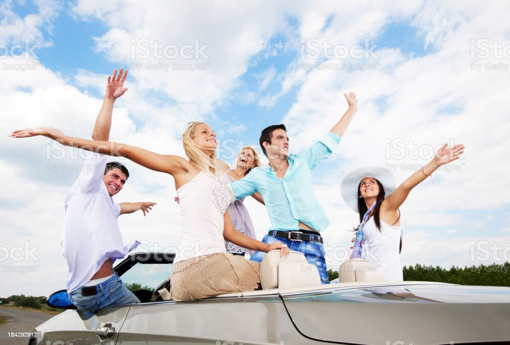 Group of young people sitting in a Convertible car. royalty-free stock photo