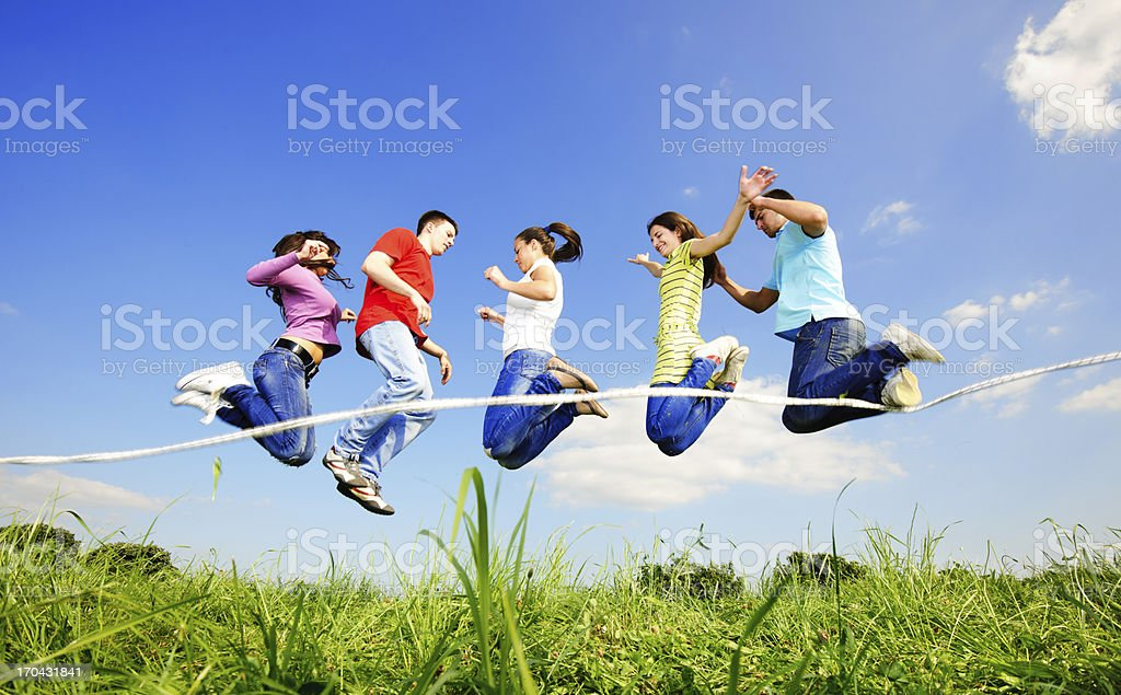Group of young people skipping stock photo