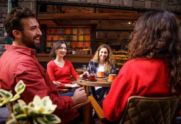 Group of Young People Socializing in a Cafe stock photo