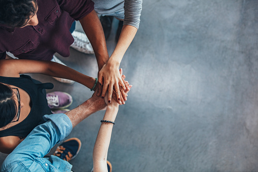 istock Group Of young people stacking their hands 627045724
