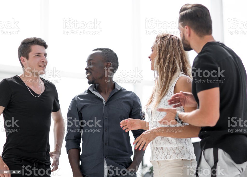 group of young people standing in the business center stock photo