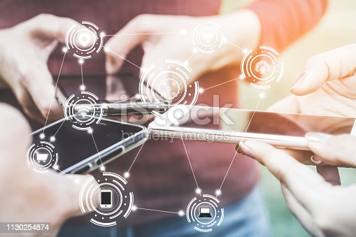 istock group of young people using smart phone for iot with digital connection 1130254874