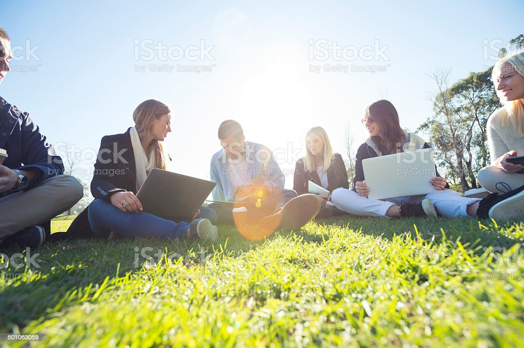 Group of young people using technology royalty-free stock photo