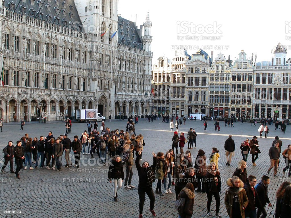 Group Of Young People Walking Looking Around At Grand Place.Brussels.Belgium.Europe stock photo