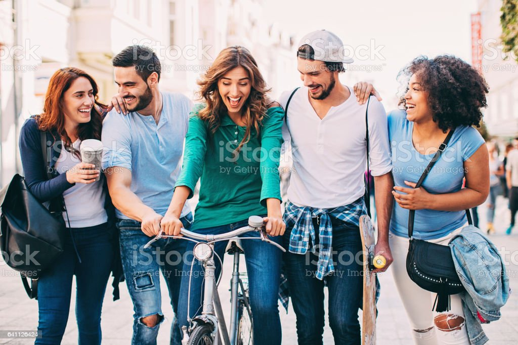 Group of young people walking outdoors stock photo