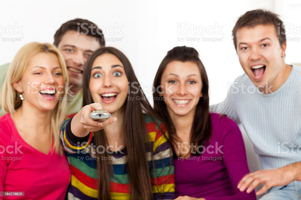 Group Of Young People Watching TV royalty-free stock photo