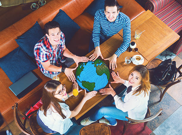 Group of young people with a drawing of a planet Earth stock photo