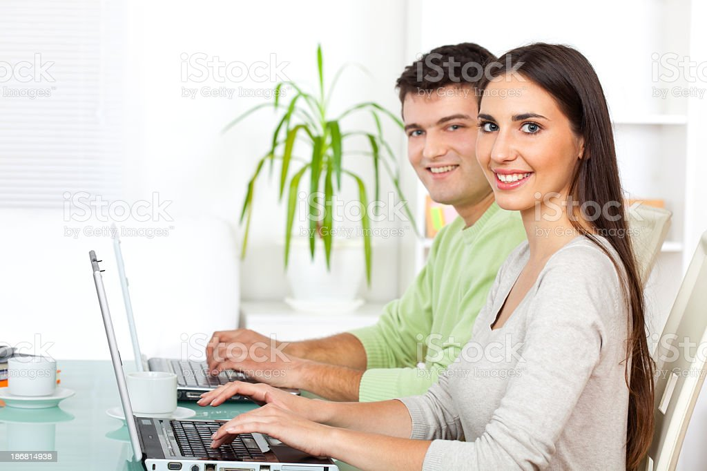 Group of young people working on laptop computer royalty-free stock photo