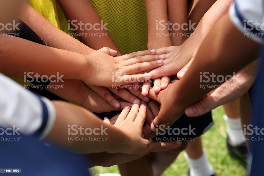 group of young people's hands stock photo