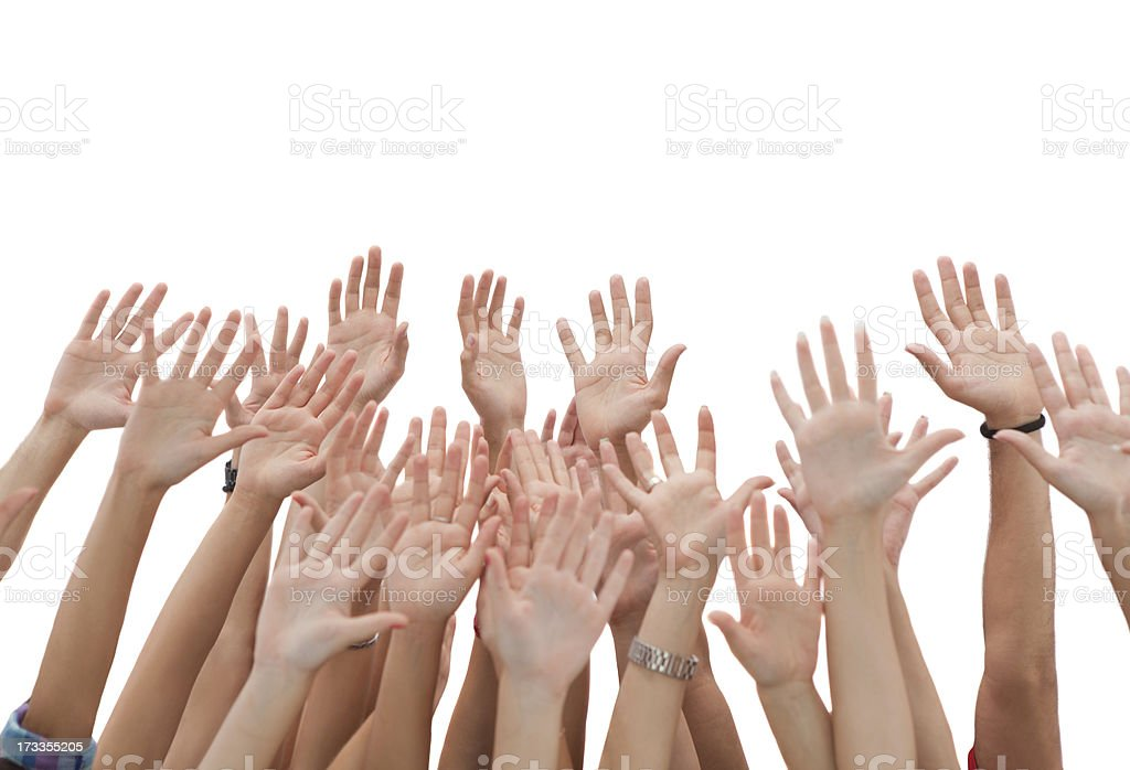 Group of young people's hands raised up. stock photo