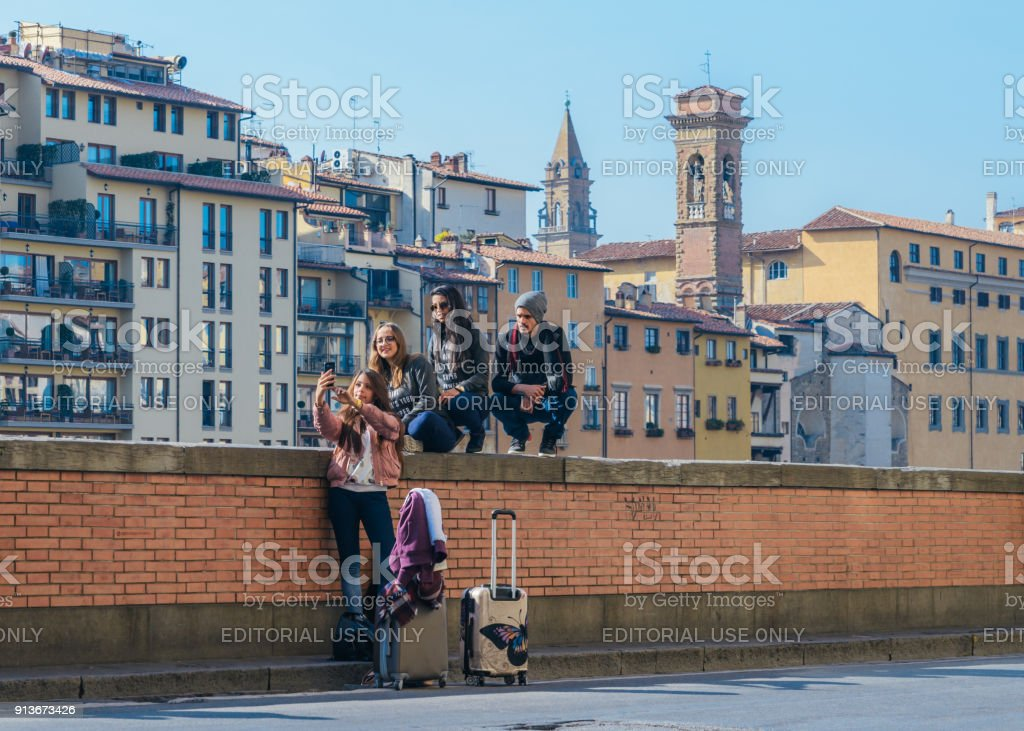Group of young persons taking a selfie, just arrived in Florence, Tuscany, Italy stock photo