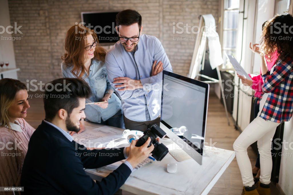 Group of young perspective designers working with camera royalty-free stock photo