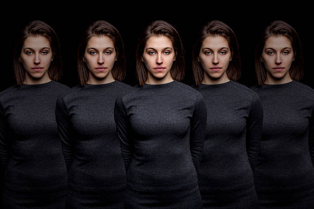 Group of young pretty women clones standing in a row stock photo