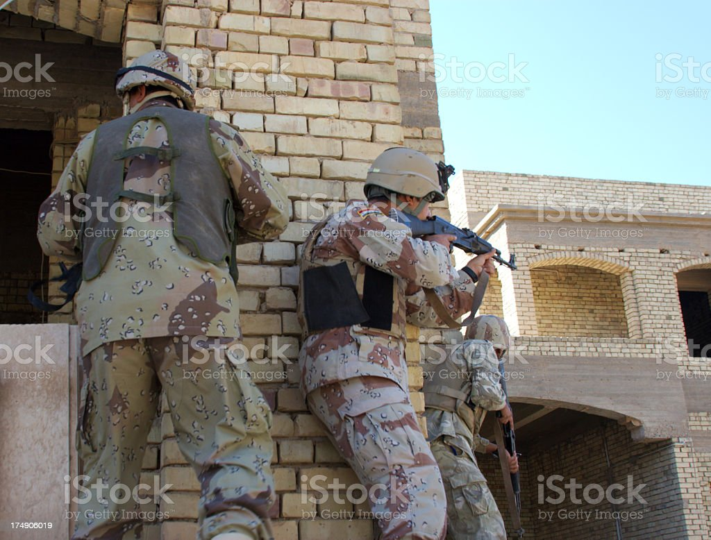 Group of young soldiers from an Iraqi Army with guns royalty-free stock photo