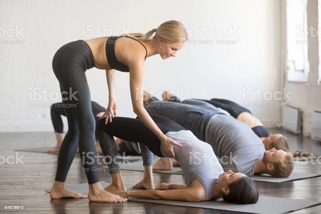 Group of young sporty people in Bridge pose stock photo