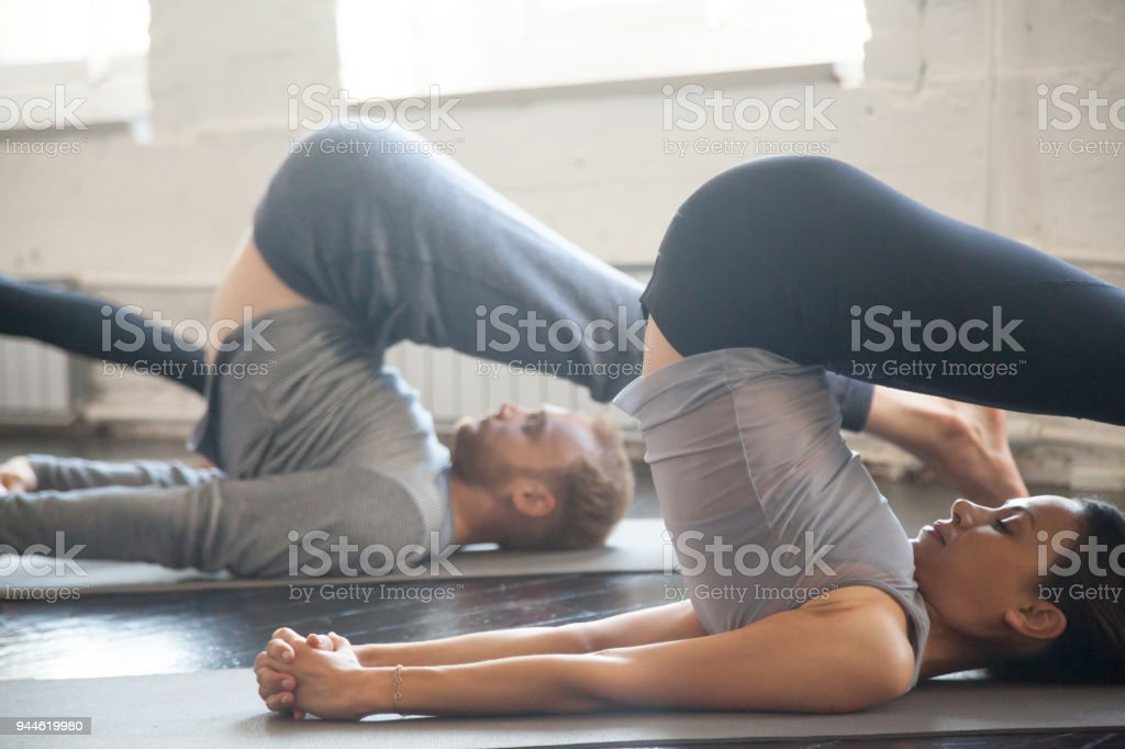 Group of young sporty people in Plough pose, close up - Royalty-free Yoga Stock Photo