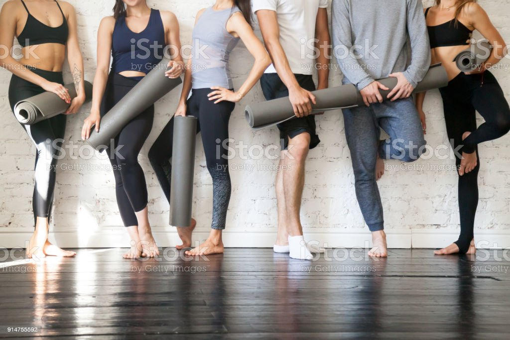 Group of young sporty people standing at wall, close up stock photo