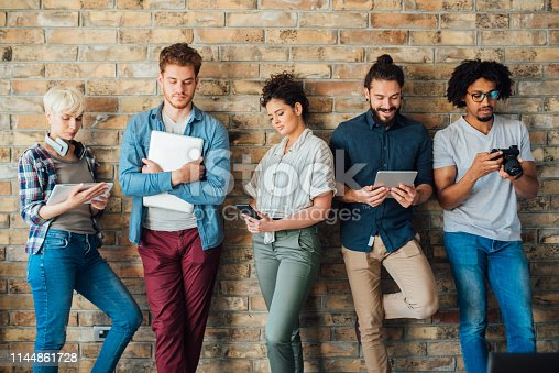 istock Group of young students 1144861728