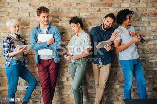 istock Group of young students together 1144861751