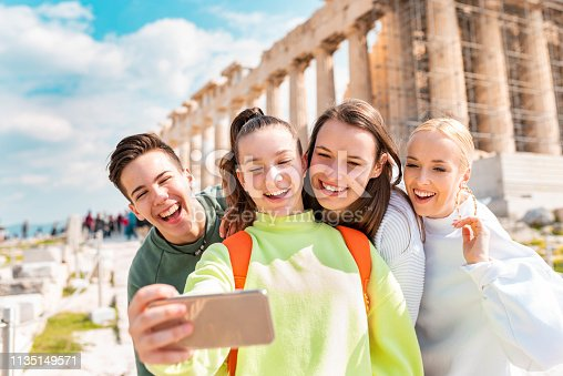 Group of young tourists taking a selfie in Acropolis - Athens.