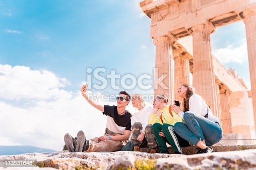Group of young tourists taking selfie in Acropolis - Athens.