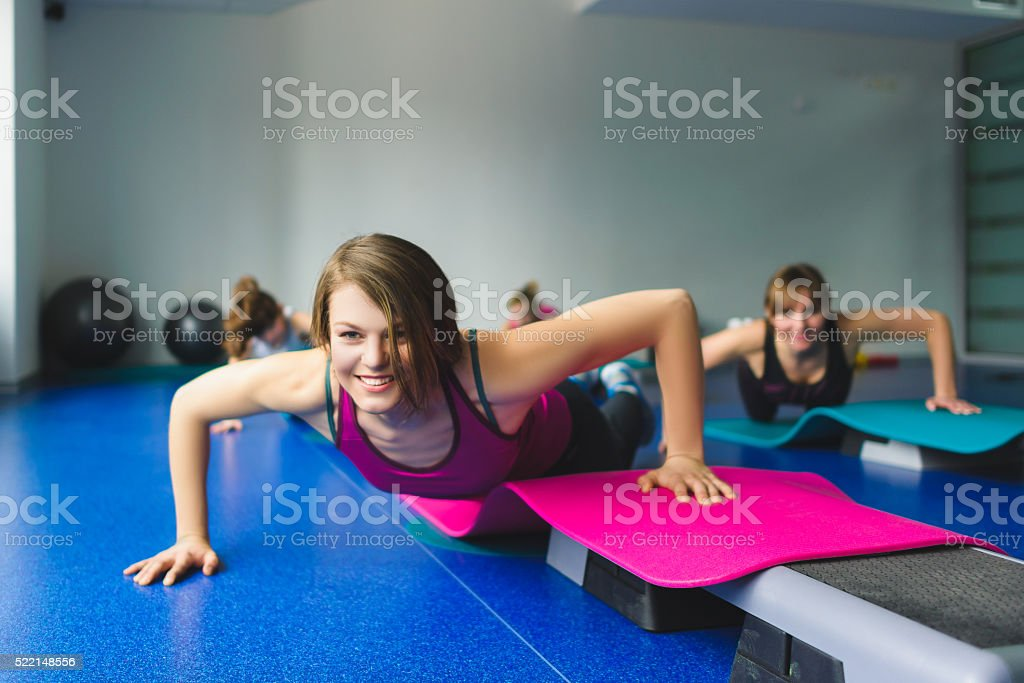 Group Of Young Woman And Little Girls Doing Gymnastic Exercises