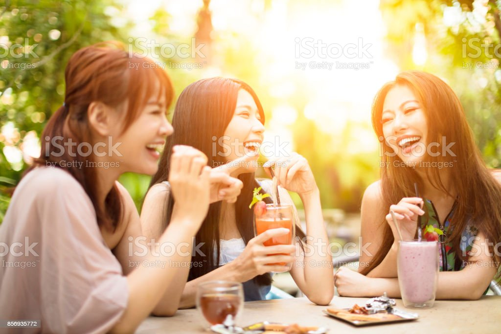 Group of young woman laughing in restaurant stock photo
