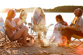group of young women enjoy a carefree summer day at a lake